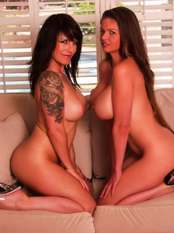 Busty brunette MILFs fuck each other on the couch